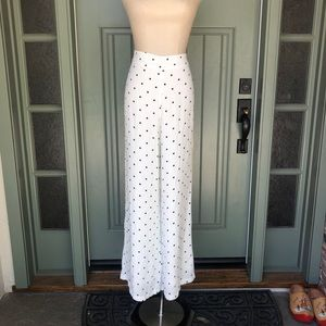 Olivaceous white pants with black polka dots
